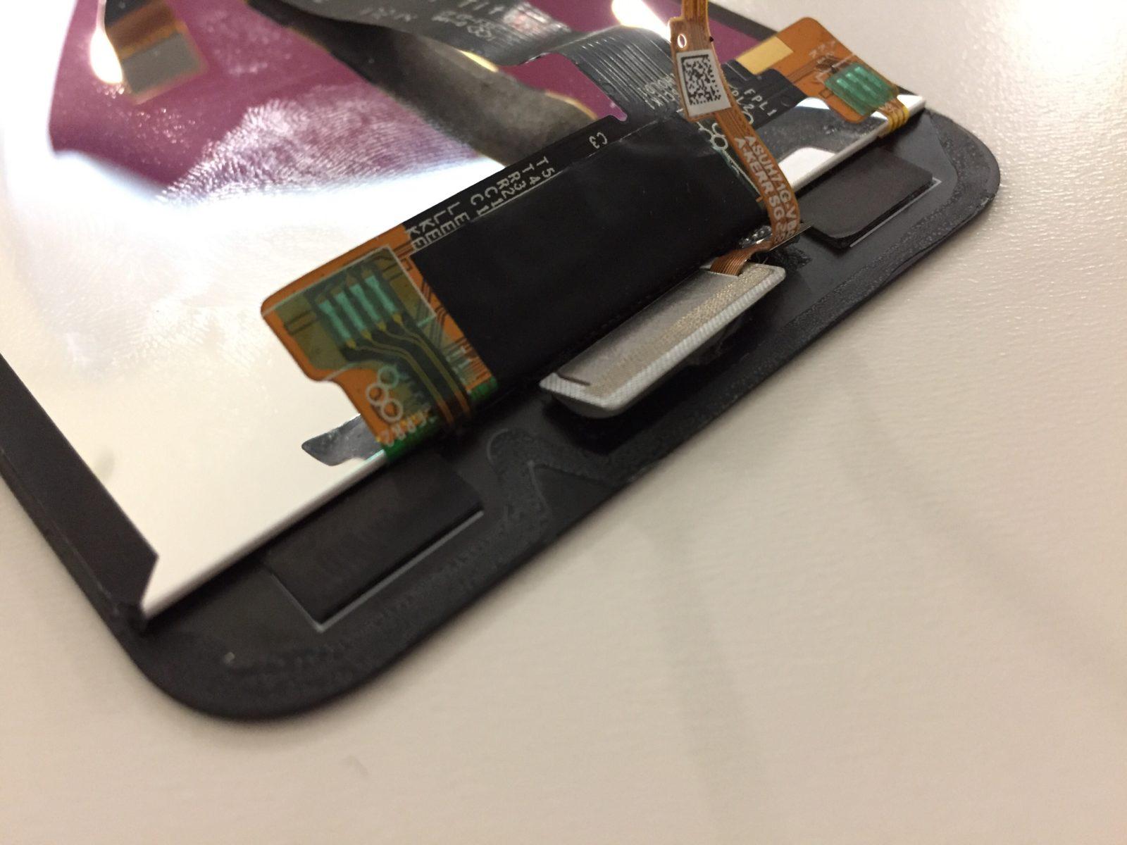 В ASUS ZenFone 4 ZE554KL разбилось стекло. Разборка и замена экрана